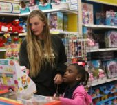 Kids shop Toys 'R' Us during Big Whit Foundation's annual spree